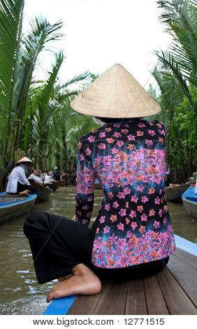 Vietnamese Woman on a Sampan at Mekong River Delta in Vietnam