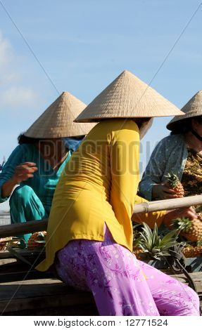 Vietnamese Vendors at the Floating Market in Mekong River Delta, Vietnam