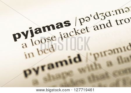 Close Up Of Old English Dictionary Page With Word Pyjamas.