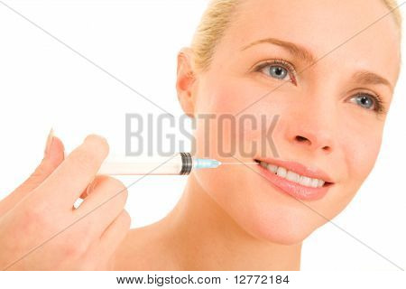 Woman with syringe of
