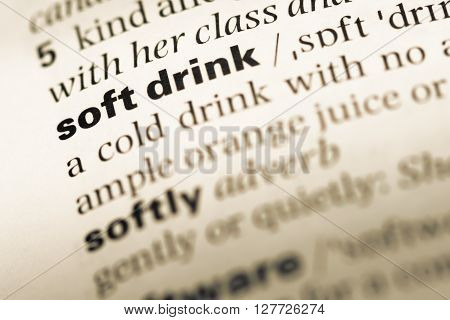 Close Up Of Old English Dictionary Page With Word Soft Drink.