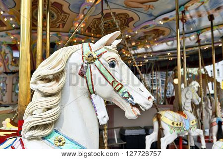 Head of a classic carousel horse with background out of focus