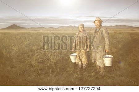 Mongolian Couple Farmers Holding Basin And Posing In The Field Concept