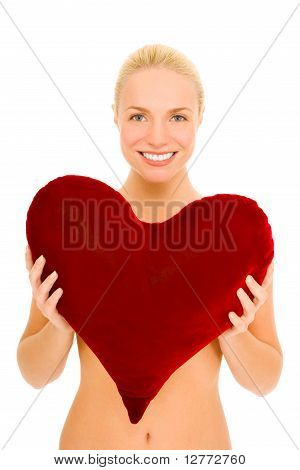 naked woman with heart-shaped pillow