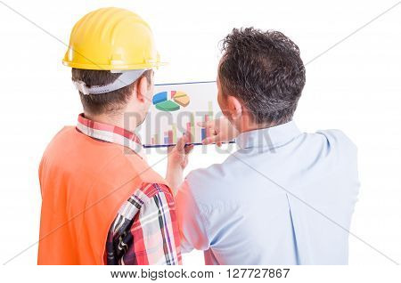Manager and contractor discussing financial charts on clipboard