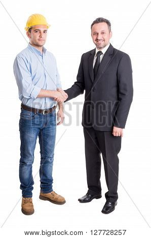 Architect engineer or contractor and suited business man shaking hands