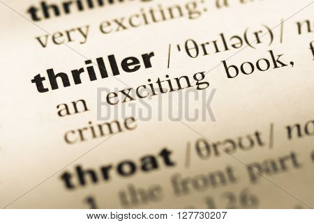 Close Up Of Old English Dictionary Page With Word Thriller.