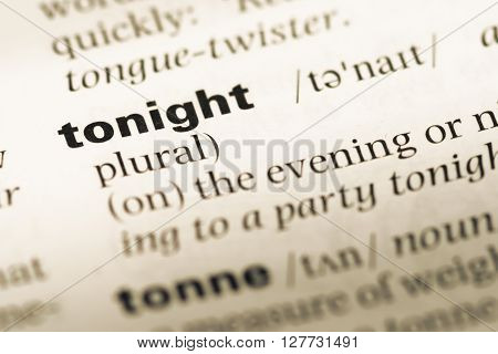 Close Up Of Old English Dictionary Page With Word Tonight.