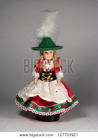 Doll souvenir in traditional German costume. Doll on a round base.