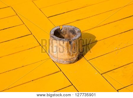Bamboo ashtray on wooden yellow paint table on the beach