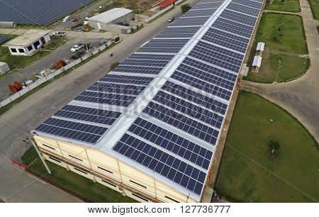Solar panels on rooftop of building as technology concept