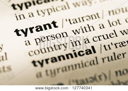 Close Up Of Old English Dictionary Page With Word Tyrant.