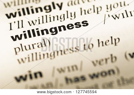 Close Up Of Old English Dictionary Page With Word Willingness.