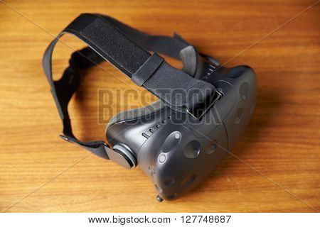 Virtual Reality Headset On Wooden Background
