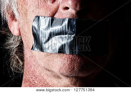 Highly detailed creepy image of man with mouth duct taped closed. Political correctness or freedom of speech concept.