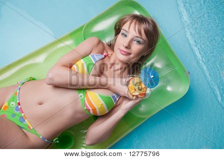 Young Woman  Lies  On An Inflatable Mattress
