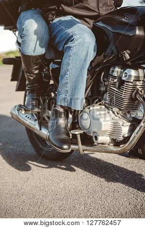 Senior couple legs with boots sitting over motorcycle ready to go