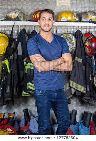 Smiling Firefighter Standing At Fire Station