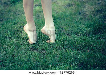 Female Barefoot On Grass