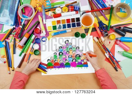 cartoon people team collection group portrait child drawing , top view hands with pencil painting picture on paper, artwork workplace
