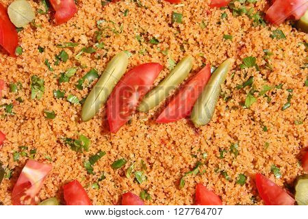 Kisir, traditional turkish salad, Bulgur wheat prepared with tomato paste, fresh tomatoes, parsley, olive oil.selective focus