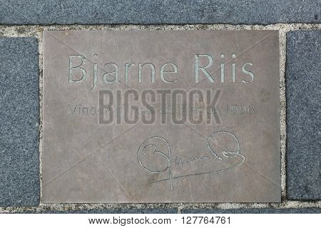 Herning, Denmark - April 9, 2016: Commemorative plaque in city of Herning, Denmark and tribute to Bjarne Riis cyclist, winner of the Tour de France in 1996