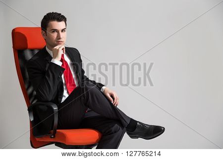 Man Sitting With Crossed Legs