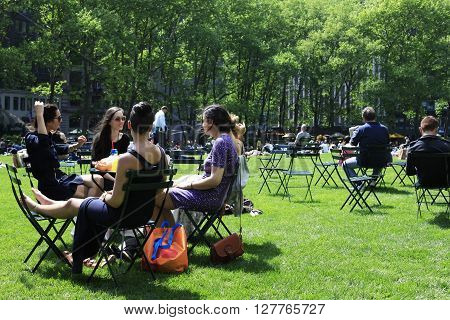 York City NY USA - May 16 2013: People enjoying a nice day in Bryant Park on May 16 2013 in New York City NY. Bryant Park is a 9603 acre privately managed park in the center of Manhattan.