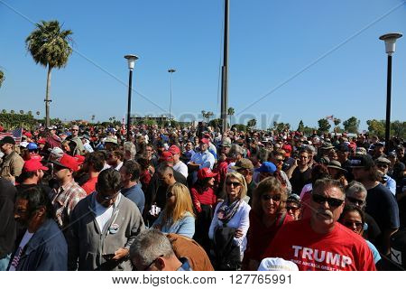Costa Mesa, CA - April 28, 2016: Estimated 31,000 supporters of republican presidential candidate Donald Trump, cheer and wait patiently in line for to hear his speech at a rally at the Costa Mesa CA.