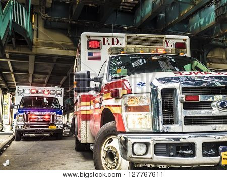 New York City, NY, USA - April 24 2016 - emergency operation - emergency vehicles and ambulances in the bronx at Pelham Pkwy station