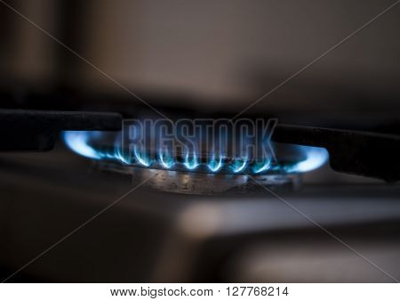 Gas burning from a kitchen gas stove. Selective focus.