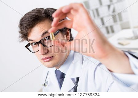Young Doctor With Pill