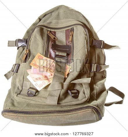 Backpack and several notes of the Ukrainian money. A backpack of color khaki it is isolated on a white background a close up