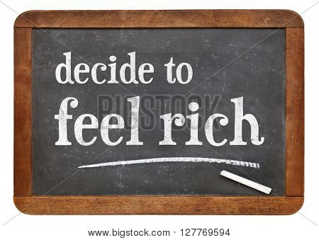 decide to feel rich advice - white chalk text on a vintage slate blackboard