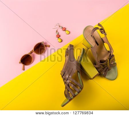 Stylish Summer Fashion Essentials On A Pink And Yellow Background
