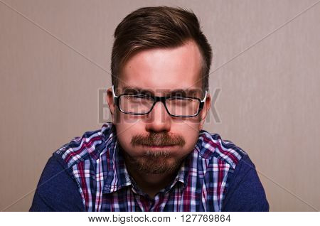 student man funny middle age guy with eyeglasses puffing his cheeks. A lot of problems keep man in depression