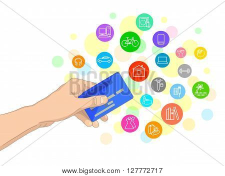 Bank card in hand and icons of possible purchases around
