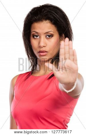 Portrait of pretty mixed race woman girl giving stop sign gesture isolated on white.