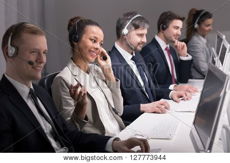 Team of call center young and full of energy agents