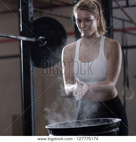 Girl Preparing To Weightlifting