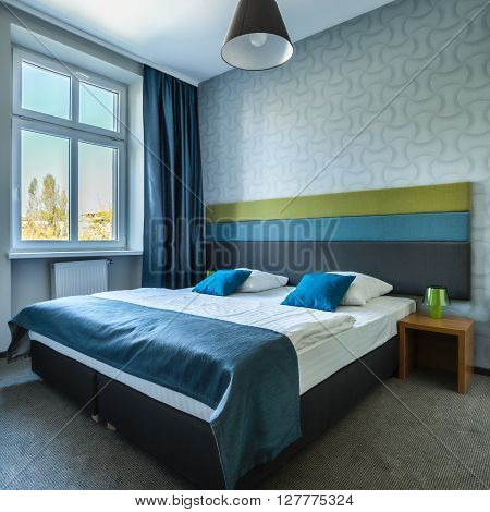 Modern cozy hotel room with double bed