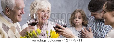 Happy Family Celebrating With Wine