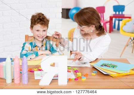 Children Therapist And Reading Lesson