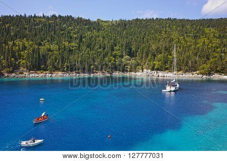 Blue waters of Foki Fiskardo Beach, Kefalonia, Ionian islands, Greece