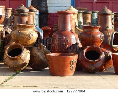 A jumble of glazed clay pots in a street market, awaiting buyers. ** Note: Soft Focus at 100%, best at smaller sizes