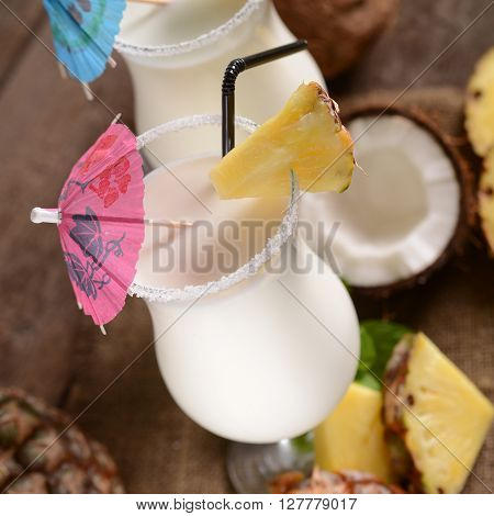 Pinacolada drink with fresh coconut on old wooden background