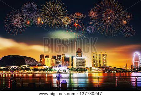 Multiple Fireworks Exploding High In The Sky Over Modern Building.