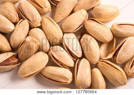 fresh Pistachio nuts on a white background