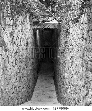 Door to catacombs with a scary end.