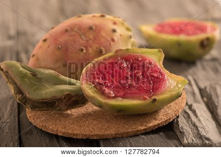 half prickly pear cactus on wooden panel